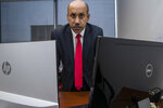 In this Oct. 26, 2018, photo Ali AlAhmed poses for a photograph in his office in Washington. Hackers are impersonating reporters in a bid to intercept the communications of the prominent Saudi opposition figure in Washington. An Associated Press review of malicious emails sent to AlAhmed shows he was approached by hackers masquerading as a BBC reporter and as Washington Post columnist Jamal Khashoggi, who was killed last month at the Saudi consulate in Istanbul. The emails were attempts to break into AlAhmed's inbox. AlAhmed blames the Saudi government for the hacking campaign, although the AP has yet to find any forensic evidence to back that.(AP Photo/Alex Brandon)