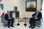 In this photo released by Lebanese government, Lebanese President Michel Aoun, left, meets with former Lebanese Prime Minister Najib Mikati, at the presidential palace, in Baabda, east of Beirut, Lebanon, Monday, July 26, 2021. Mikati, a former Lebanese premier and billionaire businessman was slated to be appointed prime minister Monday, 10 days after Saad Hariri stepped down from the job, citing key differences with President Michel Aoun amid an unprecedented financial meltdown. (Dalati Nohra/Lebanese Official Government via AP)