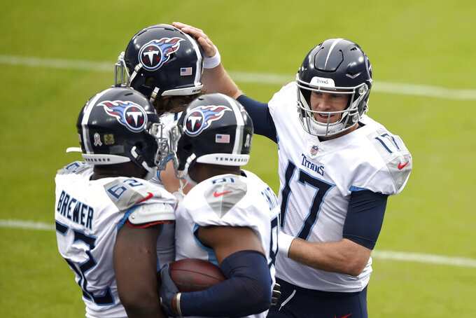 Tennessee Titans quarterback Ryan Tannehill (17) celebrates with teammates after he connected with tight end Jonnu Smith (81) on a touchdown pass against the Baltimore Ravens during the first half of an NFL football game, Sunday, Nov. 22, 2020, in Baltimore. (AP Photo/Gail Burton)