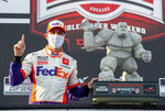 Denny Hamlin celebrates in Victory Lane after winning the NASCAR Cup Series auto race at Dover International Speedway, Saturday, Aug. 22, 2020, in Dover, Del. (AP Photo/Jason Minto)