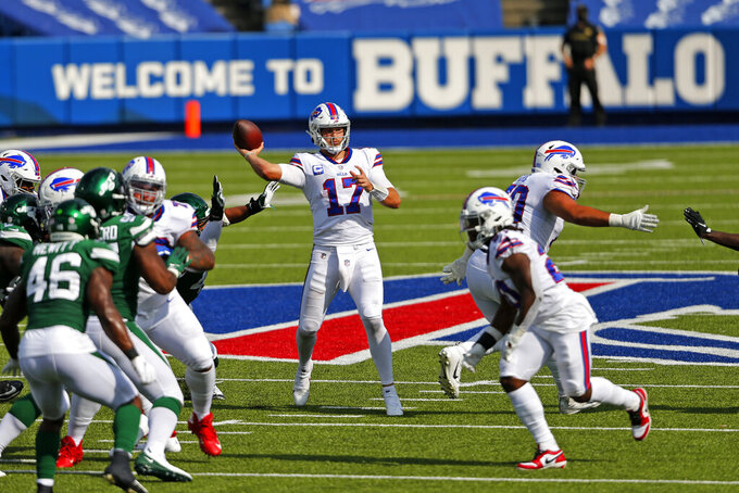 FILE - In this Sunday, Sept. 13, 2020, file photo, Buffalo Bills quarterback Josh Allen (17) throws a pass during the second half of an NFL football game against the New York Jets in Orchard Park, N.Y. If Brian Flores' rebuilding project with the Miami Dolphins is to end atop the AFC East, he must find a way to beat Josh Allen and the Bills. (AP Photo/Jeffrey T. Barnes, File)