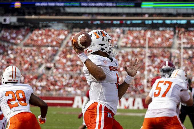 Mercer quarterback Fred Payton (4) throws to the sideline against Alabama during the first half of an NCAA college football game, Saturday, Sept. 11, 2021, in Tuscaloosa, Ala. (AP Photo/Vasha Hunt)