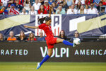 United States' Christen Press lunges for the ball during the first half of the team's international friendly soccer match against Portugal, Thursday, Aug. 29, 2019, in Philadelphia. (AP Photo/Matt Slocum)
