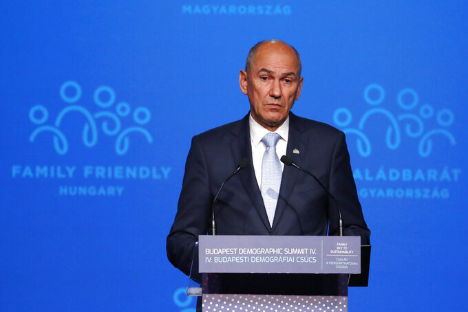 """Slovenian Prime Minister Janez Jansa holds a speech during the 4th Budapest Demographic Summit in Budapest, Hungary, Thursday, Sept. 23, 2021. The biannual demographic summit, which was first organized in 2015, offers a forum for """"pro-family thinker"""" decision-makers, scientists, researchers, and church representatives of the same sort to exchange their thoughts about connections between demographics and sustainability. (AP Photo/Laszlo Balogh)"""