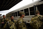 Soldiers with the 82nd Airborne Division board a bus to be taken to a flight line as they deploy to the Middle East on Saturday, Jan. 4, 2020 at Fort Bragg, N.C.  (Melissa Sue Gerrits/The Fayetteville Observer via AP)