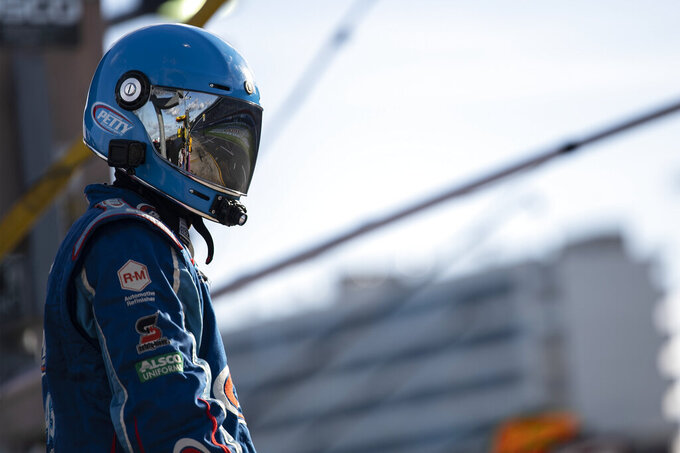 A crew member waits for Erik Jones to come down pit road during a NASCAR Cup Series auto racing race at Charlotte Motor Speedway, Sunday, Oct. 10, 2021, in Concord, N.C. (AP Photo/Matt Kelley)