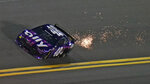 Driver Alex Bowman (48) kicks up sparks as he runs during a NASCAR Daytona 500 qualifying session Wednesday, Feb. 10, 2021, at Daytona International Speedway in Daytona Beach, Fla. Bowman took the pole position for Sunday running of the race. (AP Photo/Chris O'Meara)