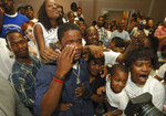 FILE - In this April 23, 2005, file photo, University of South Carolina wide receiver Troy Williamson becomes emotional while flanked by friends and family at the Peter Knox Conference Center in Augusta, Ga., after being picked by the Minnesota Vikings in the 2005 NFL draft. At far right is his mother, Shirley Williamson. There was no bigger bust than the speedster from South Carolina, who had three touchdown catches in three years. (AP Photo/The Augusta Chronicle, Shirley Williamson, File)