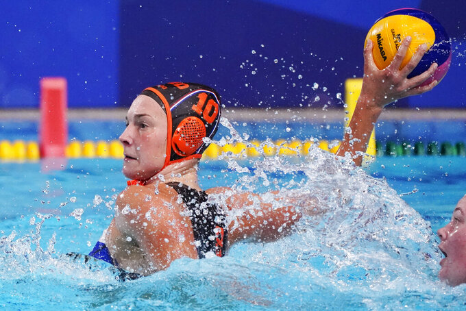 Netherland's Ilse Koolhaas shoots against South Africa during a preliminary round women's water polo match at the 2020 Summer Olympics, Friday, July 30, 2021, in Tokyo, Japan. (AP Photo/Mark Humphrey)