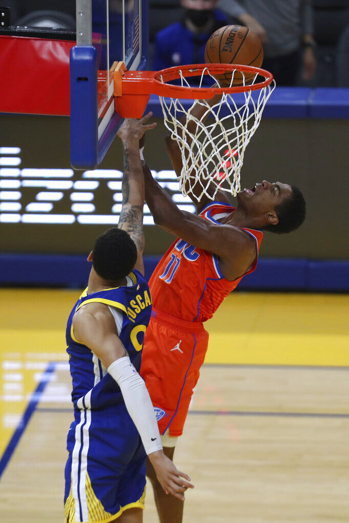 Oklahoma City Thunder's Théo Maledon, right, shoots against Golden State Warriors' Juan Toscano-Anderson during the second half of an NBA basketball game in San Francisco, Saturday, May 8, 2021. (AP Photo/Jed Jacobsohn)