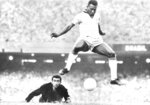 FILE - In this Aug. 1969 file photo, Brazil's Pele scores past Venezuela's goal keeper Fabrizio Fasano in Rio de Janeiro, Brazil. On Oct. 23, 2020, the three-time World Cup winner Pelé turns 80 without a proper celebration amid the COVID-19 pandemic as he quarantines in his mansion in the beachfront city of Guarujá, where he has lived since the start of the pandemic. (AP Photo, File)