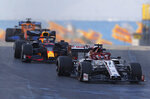 Alfa Romeo driver Kimi Raikkonen of Finland, right, steers his car in front of Red Bull driver Max Verstappen of the Netherlands and Mclaren driver Carlos Sainz of Spain during a practice session at the Istanbul Park circuit racetrack in Istanbul, Friday, Nov. 13, 2020. The Formula One Turkish Grand Prix will take place on Sunday. (AP Photo/Kenan Asyali, Pool)