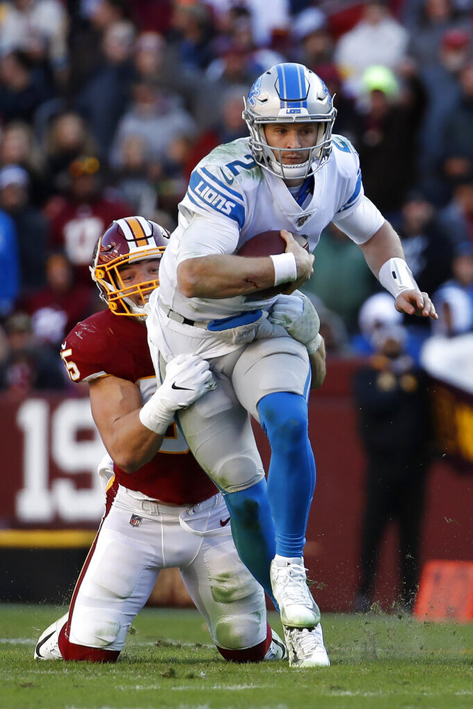 Detroit Lions quarterback Jeff Driskel (2) is sacked by Washington Redskins linebacker Cole Holcomb (55) during the first half of an NFL football game, Sunday, Nov. 24, 2019, in Landover, Md. (AP Photo/Alex Brandon)