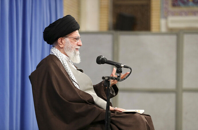 In this picture released by the official website of the office of the Iranian supreme leader, Supreme Leader Ayatollah Ali Khamenei talks to clerics in his Islamic thoughts class in Tehran, Iran, Sunday, Nov. 17, 2019. Iran's supreme leader supported the government's decision to increase gasoline prices and says that those setting fire to public property during protests against the hikes are