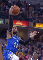 Orlando Magic guard D.J. Augustin (14) scores with a layup during the first half of an NBA basketball game against the Indiana Pacers, Saturday, March 30, 2019, in Indianapolis. (AP Photo/Doug McSchooler)