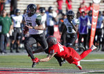 Hawaii quarterback Cole McDonald (13) is tackled by New Mexico linebacker Brandon Shook (46) during the second half of an NCAA college football game on Saturday, Oct. 26, 2019, in Albuquerque, N.M. (AP Photo/Andres Leighton)