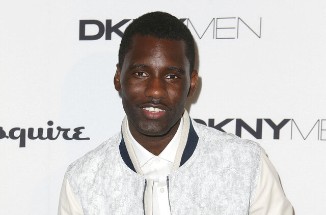 FILE - In this Sunday, June 15, 2014 file photo, British musician Wretch 32 arrives ahead of the DKNY show during London Men's spring summer fashion collections 2015, at One Embankment in central London. London's mayor has called for an investigation after rapper Wretch 32 released a video on Tuesday June 9, 2020, of his father being tasered by a police officer. (Photo by Joel Ryan/Invision/AP, File)