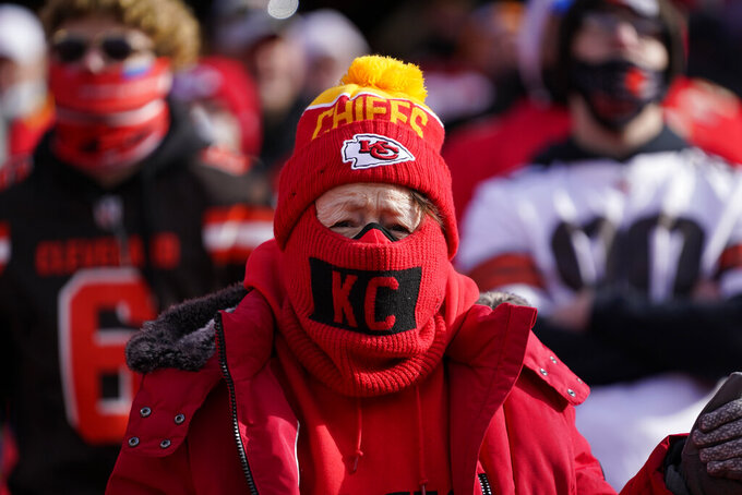 A Kansas City Chiefs fan watches from the stands during the first half of an NFL divisional round football game between the Chiefs and the Cleveland Browns, Sunday, Jan. 17, 2021, in Kansas City. (AP Photo/Jeff Roberson)