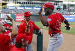 Los Angeles Angels' Brian Goodwin, right, is congratulated after hitting a two-run home run against the Texas Rangers during the first inning of a baseball game Monday, April 15, 2019, in Arlington, Texas. (AP Photo/Michael Ainsworth)