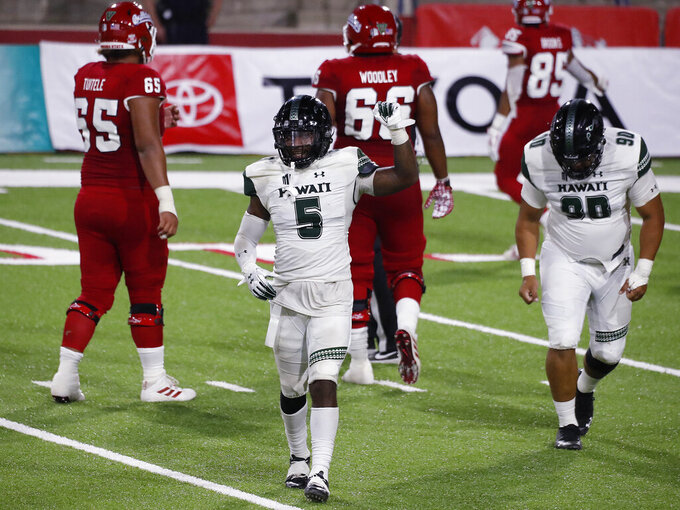 Hawaii defensive back Khoury Bethley holds up the victory sign after a fourth-down stop against Fresno State during the second half of an NCAA college football game in Fresno, Calif., Saturday, Oct. 24, 2020. (AP Photo/Gary Kazanjian)