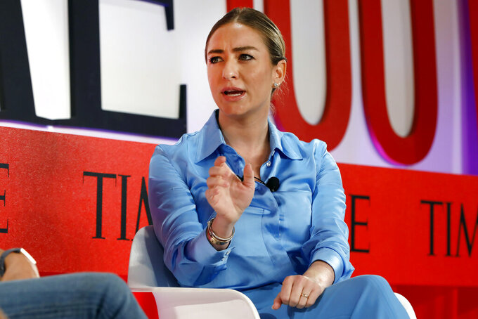 """FILE - In this Tuesday, April 23, 2019 file photo, Founder and CEO of Bumble, Whitney Wolfe Herd, speaks during the TIME 100 Summit, in New York. The Texas law, which took effect Tuesday, Aug. 31, 2021, after the Supreme Court denied an emergency appeal from abortion providers, bans abortions once medical professionals can detect cardiac activity, usually around six weeks and often before women know they're pregnant. Austin-based Bumble, which is led by CEO Whitney Wolfe, spoke out against the law on social media. """"Bumble is women-founded and women-led, and from day one we've stood up for the most vulnerable. We'll keep fighting against regressive laws like #SB8,"""" Bumble said on Twitter. (AP Photo/Richard Drew, File)"""