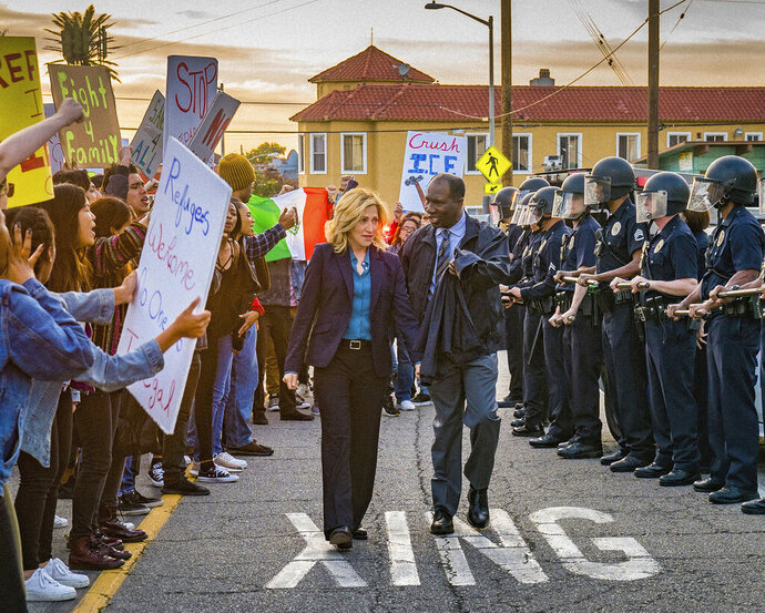 This image released by CBS shows Eddie Falco, center left, and Rusell G Jones, center right, in a scene from the new series
