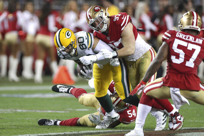 San Francisco 49ers defensive end Nick Bosa (97) brings down Green Bay Packers tight end Jimmy Graham (80) during the NFL NFC Championship football game, Sunday, Jan. 19, 2020 in Santa Clara, Calif. The 49ers defeated the Packers 37-20. (Margaret Bowles via AP)