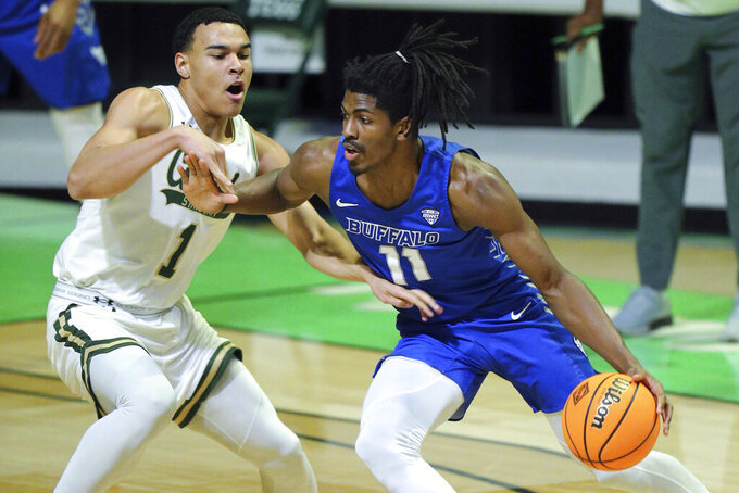 Colorado State guard John Tonje (1) defends as Buffalo forward Jeenathan Williams (11) drives during the first half of an NCAA college basketball game in the NIT, Friday, March 19, 2021, in Denton, Texas. (AP Photo/Richard W. Rodriguez)