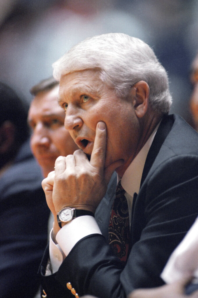 FILE - In this March 19, 1993, file photo, Arizona coach Lute Olson watches his team during a loss to Santa Clara in an NCAA men's college basketball tournament game in Salt Lake City. Olson, the Hall of Fame coach who turned Arizona into a college basketball powerhouse, has died. He was 85. Olson's family said he died Thursday evening, Aug. 27, 2020. The family didn't provide the cause of death. (AP Photo/Jack Smith, File)
