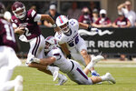 Mississippi State quarterback Will Rogers (2) is sacked by Louisiana Tech defensive lineman Ben Bell (96) during the first half of an NCAA college football game in Starkville, Miss., Saturday, Sept. 4, 2021. (AP Photo/Rogelio V. Solis)