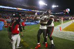 Tampa Bay Buccaneers running back Leonard Fournette (28) celebrates after a touchdown with offensive guard Ali Marpet (74) during the NFL Super Bowl 55 football game against the Kansas City Chiefs, Sunday, Feb. 7, 2021 in Tampa, Fla. (Ben Liebenberg via AP)
