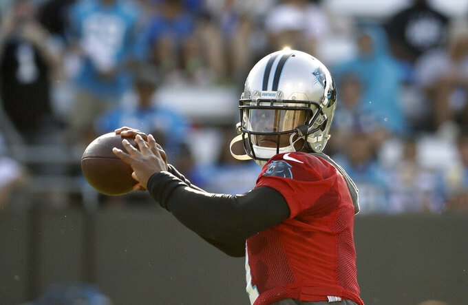 Panthers QB Newton airs it out, throws with 'no limitations'