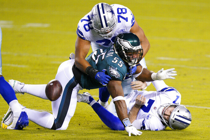 Dallas Cowboys' Ben DiNucci (7) fumbles the ball after a hit by Philadelphia Eagles' Brandon Graham (55) as Terence Steele (78) defends during the first half of an NFL football game, Sunday, Nov. 1, 2020, in Philadelphia. (AP Photo/Chris Szagola)