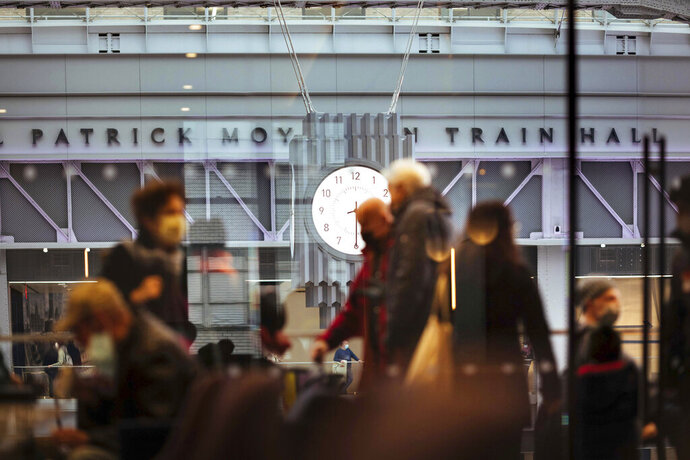 FILE - In this Jan. 1, 2021 file photo, The Amtrak Metropolitan Lounge overlooks the newly-completed Moynihan Train Hall in New York. Two major railroad workers unions have asked the Department of Homeland Security to beef up security on Amtrak and other passenger rail lines, including by creating a no-ride list akin to the no-fly list that prevents people identified as risks from boarding planes. The unions said Wednesday, Jan. 13, 2021, that tougher security measures are needed after last week's riot at the U.S. Capitol because people who took part in the insurrection that were placed on the no-fly list may turn to railroads for transportation. (AP Photo/Kevin Hagen File).