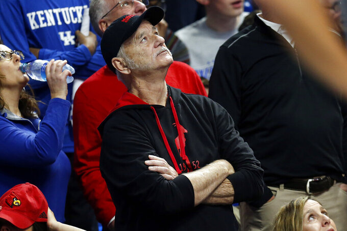 Bill Murray looks at the scoreboard during the first half of an NCAA college basketball game between Kentucky and Louisville in Lexington, Ky., Saturday, Dec. 28, 2019. Murray's son is an assistant in Louisvile. (AP Photo/James Crisp)