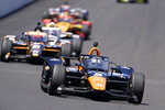 Pato O'Ward, of Mexico, drives into Turn 1 during the Indianapolis 500 auto race at Indianapolis Motor Speedway, Sunday, May 30, 2021, in Indianapolis. (AP Photo/Darron Cummings)