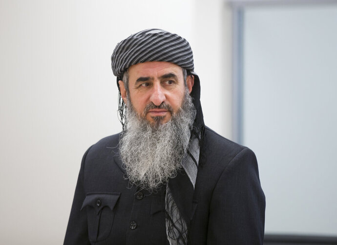 FILE - This June 13, 2016, file photo shows Najmuddin Ahmad Faraj, better known as Mullah Krekar, at Oslo District Court in Oslo, Norway.  The Norwegian domestic security agency says the Muslim cleric found guilty in Italy for planning terror has been detained on an Italian arrest warrant. Iraqi-born Krekar was detained late Monday, July 15, 2019. (Terje Pedersen/NTB Scanpix via AP, File)