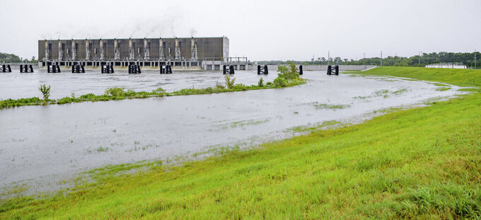 FILE - This Saturday, July 13, 2019, file photo shows the Gulf Intracoastal Waterway West Closure Complex, in Belle Chasse, La. It is the largest pumping station in the world and is part of the Southeast Louisiana Flood Protection Authority-West and the West Jefferson (Parish) and Algiers Levee District serving the residents of West Bank of the Greater New Orleans. Hurricane Ida's landfall tested the complex system of seawalls, levees and other flood control infrastructure installed to ensure that New Orleans never faces a breach like it did from Katrina. (AP Photo/Matthew Hinton, File)