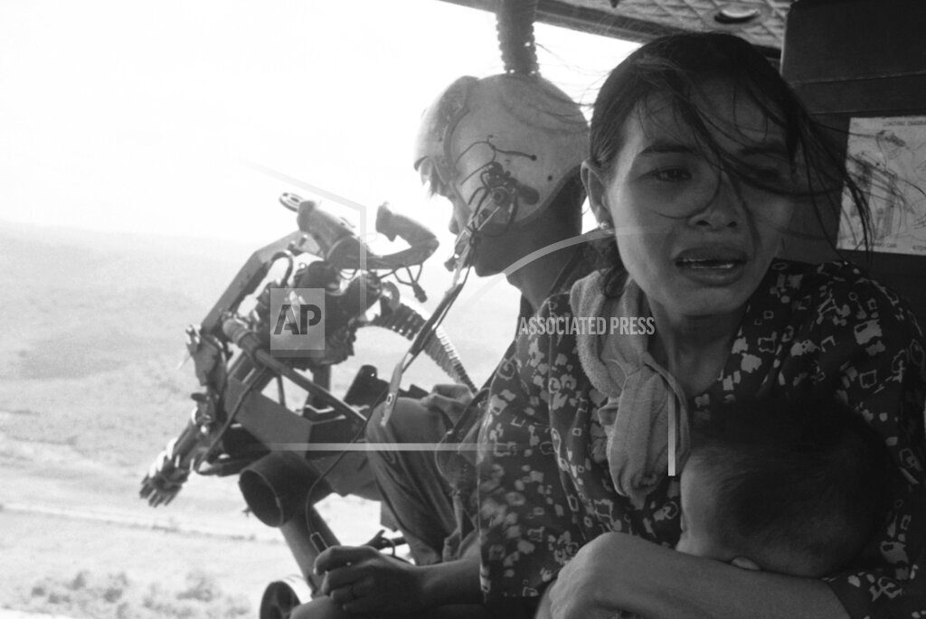 Watchf AP I   VNM APHS299733 Vietnam  (S) Refugees Fleeing  Helicopter