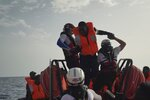 A man is assisted by SOS Mediterranee staff during a rescue operation in the Mediterranean Sea, Wednesday, Sept. 18, 2019. The Ocean Viking pulled over 70 migrants from a rubber boat north of Libya.(AP Photo/Renata Brito)
