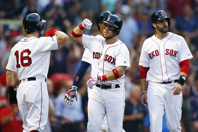 Boston Red Sox's Michael Chavis, front center, celebrates his grand slam that also drove in Andrew Benintendi (16), Xander Bogaerts, back center, and J.D. Martinez, right, during the first inning of a baseball game against the Toronto Blue Jays in Boston, Monday, July 15, 2019. (AP Photo/Michael Dwyer)