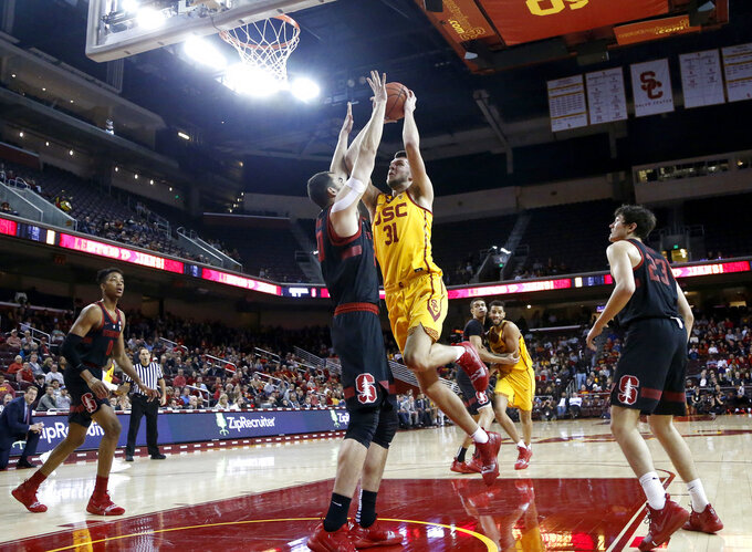 Southern California's Nick Rakocevic, 2nd right, goes to basket while defended by Stanford's Josh Sharma, 2nd left, during the first half of an NCAA college basketball game Sunday, Jan. 6, 2019, in Los Angeles. (AP Photo/Ringo H.W. Chiu)