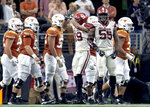 Oklahoma linebacker Caleb Kelly (19) and defensive lineman Kenneth Mann (55) celebrate a safety as Texas' offense walks to the sideline during the Big 12 Conference championship NCAA college football game in Arlington, Texas, on Saturday, Dec. 1, 2018.  (Nick Wagner/Austin American-Statesman via AP)
