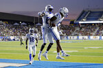 Duke wide receiver Eli Pancol (6) celebrates with Damond Philyaw-Johnson (85) after scoring a touchdown against Middle Tennessee in the first half of an NCAA college football game Saturday, Sept. 14, 2019, in Murfreesboro, Tenn. (AP Photo/Mark Humphrey)