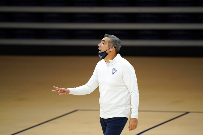 Villanova head coach Jay Wright reacts during the second half of an NCAA college basketball game against Saint Joseph's, Saturday, Dec. 19, 2020, in Villanova, Pa. (AP Photo/Matt Slocum)
