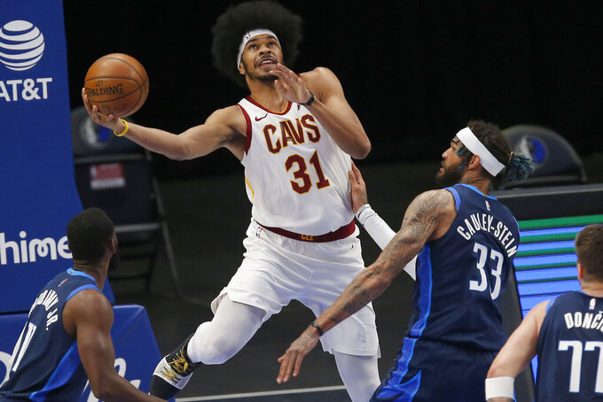 FILE - In this May 7, 2021, file photo, Cleveland Cavaliers center Jarrett Allen (31) drives to shoot against Dallas Mavericks defenders Willie Cauley-Stein (33) and Tim Hardaway Jr. (11) during the first half of an NBA basketball game in Dallas. The Cavaliers extended a qualifying offer to Allen, making him a restricted free agent. The team had until Aug. 1 to make the offer to Allen, a 23-year-old acquired last season in a trade from Brooklyn and viewed as one of Cleveland's core pieces. (AP Photo/Brandon Wade, File)