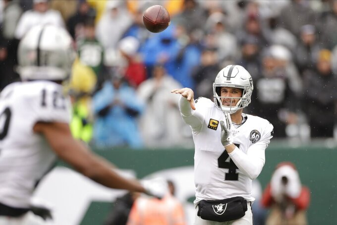 Oakland Raiders quarterback Derek Carr (4) throws a pass to Zay Jones (12) during the first half of an NFL football game Sunday, Nov. 24, 2019, in East Rutherford, N.J. (AP Photo/Adam Hunger)