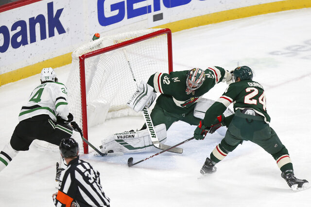 Minnesota Wild's goalie Alex Stalock (32) blocks the shot of Dallas Stars' Denis Gurianov, of Russia, in the first period of an NHL hockey game Saturday, Jan. 18, 2020, in St. Paul, Minn. (AP Photo/Stacy Bengs)