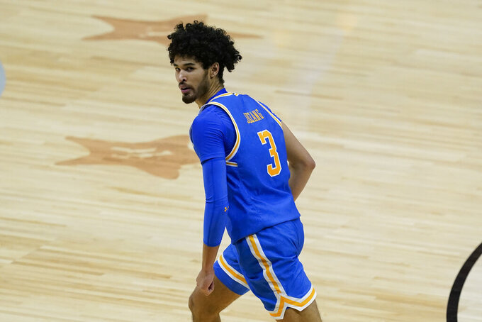 UCLA guard Johnny Juzang reacts after making a 3-point basket during the second half of a men's Final Four NCAA college basketball tournament semifinal game against Gonzaga, Saturday, April 3, 2021, at Lucas Oil Stadium in Indianapolis. (AP Photo/Darron Cummings)