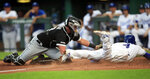 Chicago White Sox catcher James McCann, left, tags out Kansas City Royals' Alex Gordon (4) during the third inning of a baseball game at Kauffman Stadium in Kansas City, Mo., Tuesday, July 16, 2019. (AP Photo/Orlin Wagner)